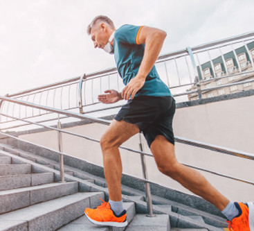 man running up steps in workout gear