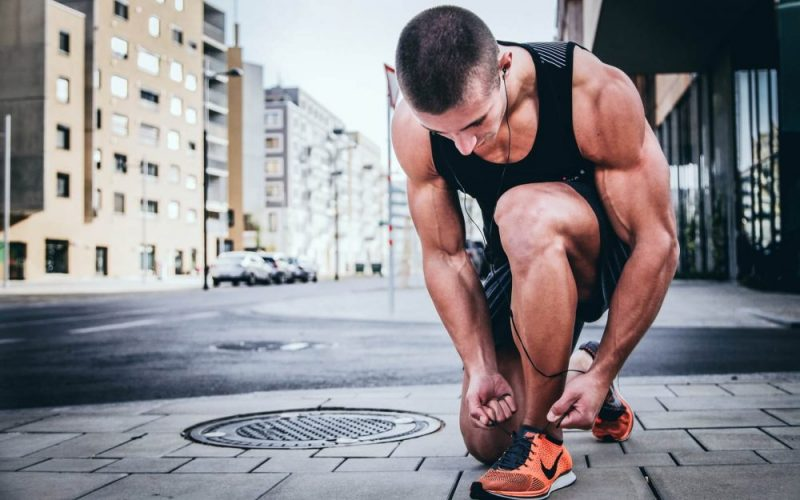 man doing hiit running exercise in street