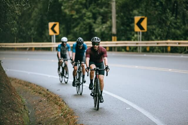 men cycling as they learn how to train for a triathlon